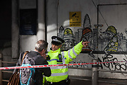 36 hours after the London Bridge and Borough Market terrorist attack, the capital returns to normality and Londoners return to their first day to work so Police officers help with directions as roads are still closed to traffic and pedestrian use, on Monday 5th June 2017, in the south London borough of Southwark, England. Seven people were killed and many others left with life-changing injuries - but the British spirit of defiance and to carry on with every day life, endures.