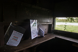 Calvert, UK. 27 July, 2020. Notices left by environmental activists from Stop HS2 in a bird hide at Calvert Jubilee Nature Reserve. On 22nd July, the Berks, Bucks and Oxon Wildlife Trust (BBOWT) reported that it had been informed of HS2's intention to take possession of part of Calvert Jubilee nature reserve, which is home to bittern, breeding tern and some of the UK's rarest butterflies, on 28th July to undertake unspecified clearance works in connection with the high-speed rail link.