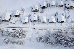 THEMENBILD - Luftaufnahme von Schneebedeckten Häusern im Ortsteil Ködnitz, am Donnerstag 10. Dezember 2020 in Kals. Aufgenommen mit einer Drohnen nach den starken Schneefällen welche vom 5. bis 8. Dezember 2020 für grosse Neuschneemengen in Oberkärnten und Osttirol sorgten // Aerial view of snow-covered houses in Kals Koednitz, on Thursday December 10, 2020 in Kals. Photo taken with a drone after the heavy snowfalls which caused large amounts of new snow in Upper Carinthia and East Tyrol from December 5th to 8th, 2020. EXPA Pictures © 2020, PhotoCredit: EXPA/ Johann Groder