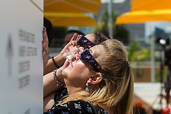 Aileen Hernandez and Carry Hernandez, back, take a look at the solar eclipse at the Phillip and Patricia Frost Museum of Science with the collaboration of Southern Cross Astronomical Society on Monday, Aug. 21, 2017. Photo by Sebastian Ballestas/Miami Herald/TNS/ABACAPRESS.COM