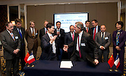 Shanghai Office of Financial Services Director-General Fang Xinghai (first row, left) and GDF Suez CEO and Paris Europlace Chairman Gerard Mestrallet (first row, right), sign a Memorandum of Understanding between Paris Europlace and Shanghai Financial Services, at Shanghai / Paris Europlace Financial Forum, in Shanghai, China, on December 1, 2010. Photo by Lucas Schifres/Pictobank