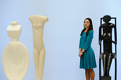 """© Licensed to London News Pictures. 08/05/2017. London, UK. A staff member stands with (L to R) """"Woman with her Throat Cut"""", 1932; """"Walking Woman (I)"""", 1932 and """"Spoon Woman"""", 1927.  Preview of the UK's first major retrospective of Alberto Giacometti for 20 years at Tate Modern.  The exhibition runs 10 May to 10 September 2017. Photo credit : Stephen Chung/LNP"""