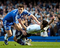 Photo: Ed Godden/Sportsbeat Images.<br /> Chelsea v Tottenham Hotspur. The FA Cup. 11/03/2007.<br /> Chelsea's Frank Lampard (L), colides with Hossam Ghaly.