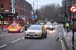 © Licensed to London News Pictures. 31/12/2018. London, UK. The scene at Fulham Palace Road in Hammersmith, West London where 39 people were arrested following the attempted murder of a man in a stabbing. Photo credit: Ben Cawthra/LNP