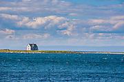 Little house on a sand island of the coast of Flower Cove, Newfoundland, Canada