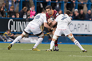 Nick Crosswell of the Newport Gwent Dragons (C) is stopped in his tracks by Josh Turnbull (L) and Sam Warburton (R) of the Cardiff Blues Guinness Pro12 rugby match, Cardiff Blues v Newport Gwent Dragons at the Cardiff Arms Park in Cardiff, South Wales on Sunday 17th April 2016.<br /> pic by Simon Latham, Andrew Orchard sports photography.
