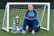 Steven Naismith (#14) of Heart of Midlothian FC poses with the Scottish Cup during the Heart of Midlothian press conference, media and training session, ahead of the William Hill Scottish Cup Final, at the Oriam Sports Performance Centre, Edinburgh, Scotland on 15 December 2020.<br /> <br /> *** EMBARGOED UNTIL 18/12/2020 ***