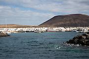 Caleta de Sebo village and Agujas Grandes volcano, La Isla Graciosa, Lanzarote, Canary Islands, Spain