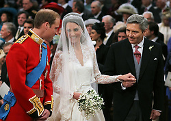 File photo dated 29/04/11 of Prince William and Kate Middleton with her father Michael Middleton at Westminster Abbey, London. The Duchess of Cambridge will have spent a decade as an HRH when she and the Duke of Cambridge mark their 10th wedding anniversary on Thursday. Issue date: Wednesday April 28, 2021.