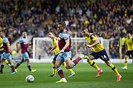 Robert Snodgrass (11) of West Ham United is chased by Anthony Forde (14) of Oxford United during the EFL Cup match between Oxford United and West Ham United at the Kassam Stadium, Oxford, England on 25 September 2019.