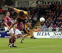 Photo: Richard Lane.<br />Northampton Town v Hull City. Nationwide Division Three. 04/10/2003.<br />Jason Price gets up to score Hull's third goal.