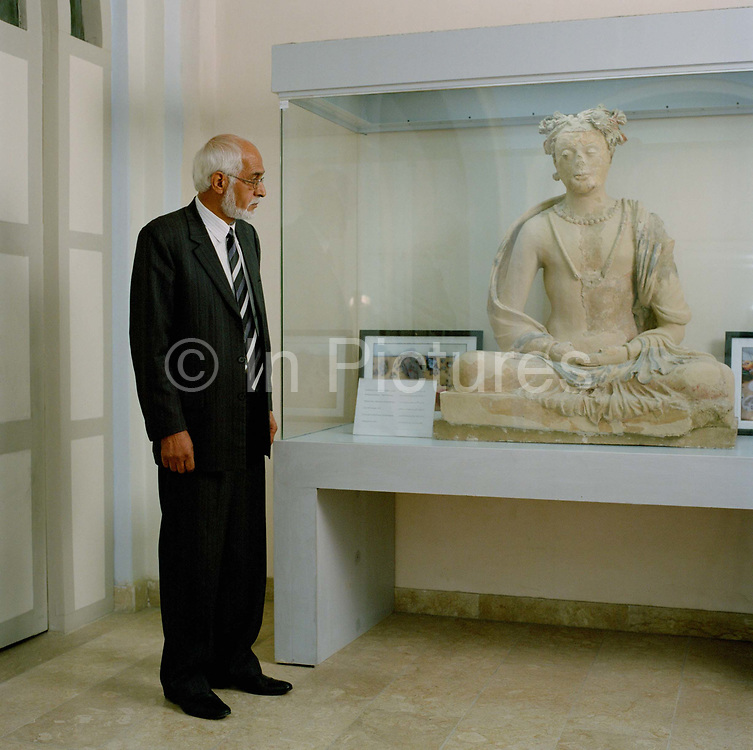 """Mr Massoudi,  Director of the  National Museum of Afghanistan pictured next to a statue recently restored after the Taliban smashed it to pieces. Overall the Taliban smashed 2000 museum exhibits and more famously two colossal Buddhas in Bamiyan 'because they were """"false idols"""" contrary to Islam.  Mr Massouudi with the help of the international community has rebuilt and reopened his museum and is now seeking to recover and restore the many artifacts either looted in the civil war or smashed by the Taliban:<br /> """"They took the decision that artefacts such as statues, or anything representing the human figure, was against Sharia Islam . Looking at statues as part of history, is not the same as worshiping them. It was an extremely sad time not just for me, but all museum staff , cultural and educated people in Afghanistan. They destroyed around 2000 artefacts."""""""