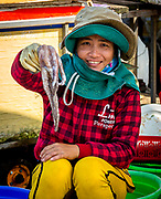 Dec. 2018, Hoi An: Friendly Vietnamese lady selling her catch of the day. RAW to Jpg