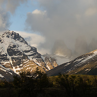 Morning clouds billow over the Towers of Paine & Monte Almirante Nieto (L) in Torres del  Paine National Park in Patagonia, Chile