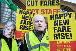 © Licensed to London News Pictures. 02/01/2019. London, UK. Protesters wearing Theresa May and Chris Grayling masks outside King's Cross as passengers begin a 'national day of action' over 3. 1% fare increases. Photo credit: Rob Pinney/LNP