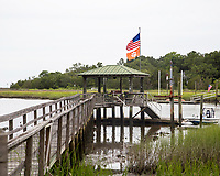 Dock on Jeremy Creek with American Flag and Orange Clemson University Flag, McClellanville, South Carolina photo by catherine brown