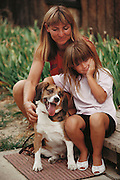Experimental cryonics: The family of scientist Paul Segall at home in Berkeley, California, with the family dog Miles, a beagle. Segall replaced Miles' blood with a substitute before cooling him to 37.4 degrees & disconnecting a heart lung machine. After 15 minutes, during which Miles' pulse, breathing & circulation had ceased, the dog was warmed, its blood returned & Miles was restored to health. MODEL RELEASED 1992.