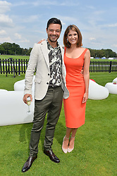 DOMINIC COOPER and GEMMA ARTERTON at the Audi International Polo at Guards Polo Club, Windsor Great Park, Egham, Surrey on 26th July 2014.