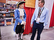 CINDY BIGGS, plays Caesar Rodney, from the colony of Delaware and one of the original signers of the Declaration of Independence, and talks to BILL RAYMOND from Mesa, AZ, at the Policy Summit in Phoenix, AZ, Friday. The Tea Party Patriots American Policy Summit starts in Phoenix Friday and goes through Sunday Feb. 27. About 2,000 people are expected to attend the event, which organizers said is meant to unite Tea Party groups across the country. Speakers include former Minnesota Governor Tim Pawlenty, Texas Congressman Ron Paul, former Clinton advisor Dick Morris and conservative blogger Andrew Brietbart. The event ends with a presidential straw poll Sunday.   Photo by Jack Kurtz