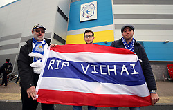 Leicester City fans with a flag of Thailand in memory of Vichai Srivaddhanaprabha outside the stadium before the match against Cardiff City at Cardiff City Stadium