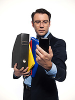 man businessman holding documents looking at phone isolated studio on white background