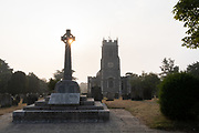 Holy Trinity church and the war memorial for both world wars, on 14th August 2020, in Loddon, Norfolk, England.