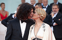 Singer Francesco Motta and Carolina Crescentini  kiss at the First Man Premiere, Opening Ceremony and Lifetime Achievement Award To Vanessa Redgrave at the 75th Venice Film Festival, Sala Grande on Wednesday 29th August 2018, Venice Lido, Italy.
