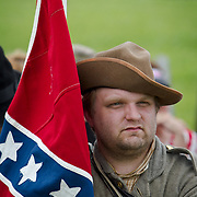 Living Historian, Dan Wambaugh, of Charlotte, Michigan, waits to participate as part of the Color Guard of Garnett's Brigade in the Pickett's Charge Commemorative March, during the Sesquicentennial Anniversary of the Battle of Gettysburg, Pennsylvania on Wednesday, July 3, 2013.  The march was an opportunity for visitors to follow in the footsteps of Confederate soldiers by walking with living historians and park rangers along the path of the famously ill-fated Pickett's Charge, which brought to a close The Battle of Gettysburg when the Union Army repelled their advance. The Battle of Gettysburg lasted from July 1-3, 1863 resulting in over 50,000 soldiers killed, wounded or missing.  John Boal Photography