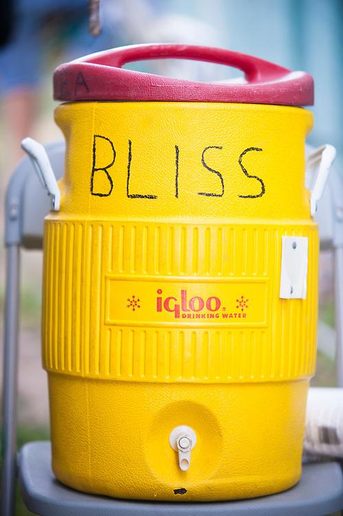 An water cooler awaits thirsty Blissfest music festival attendees.