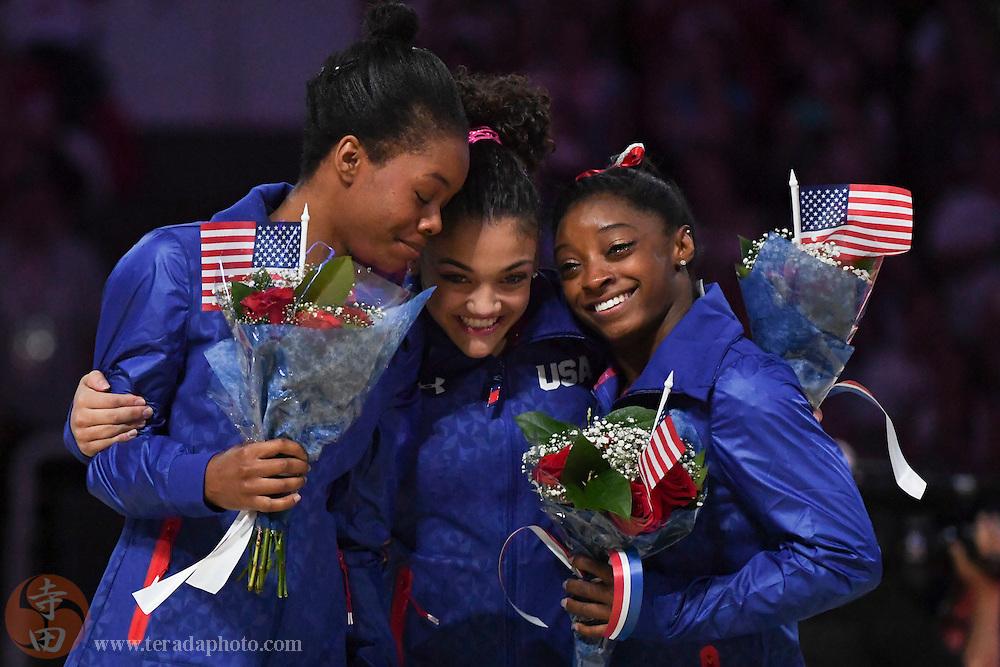 July 10, 2016; San Jose, CA, USA; Gabby Douglas (left), Laurie Hernandez (center), and Simone Biles (right) hug after the women's gymnastics U.S. Olympic team trials at SAP Center.