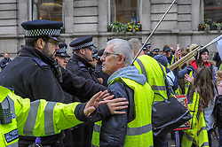 Yellow vest UK marchers met anti racism demonstrators near Trafalgar Square after police blocked their route, London, 16 March 2019