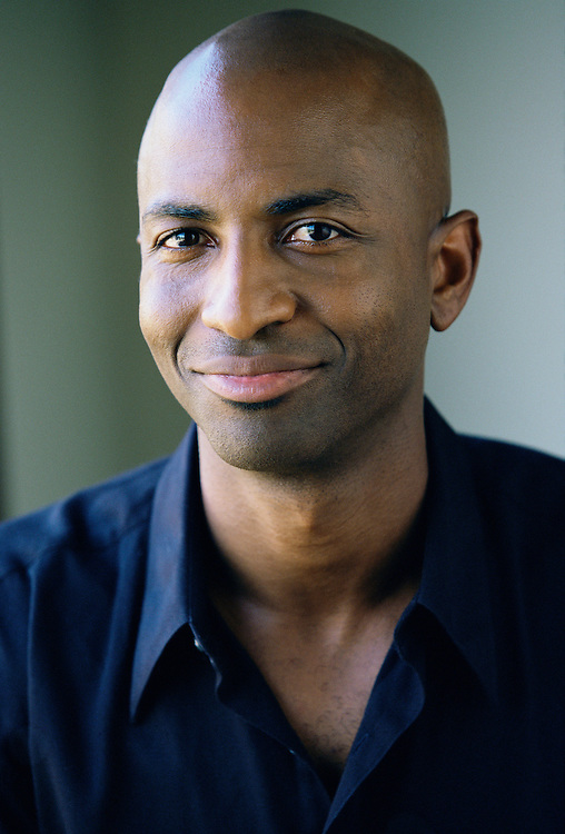Portrait of an African American man in his 30's.