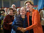 04 NOVEMBER 2019 - GRINNELL, IOWA: US Senator ELIZABETH WARREN (D-MA), right, poses for a selfie with local residents in Grinnell. Sen. Warren spoke to a crowd of about 850 students and local residents. She brought her campaign to be the Democratic nominee for the US Presidency to the college town of Grinnell, Iowa, Monday. Iowa holds the first selection event of the 2020 presidential election cycle. The Iowa caucuses are Feb. 3, 2020.           PHOTO BY JACK KURTZ