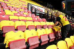 Yellow and black t-shirts are placed on the seats ahead of the Premier League match at Vicarage Road, Watford