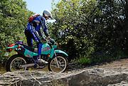 Chris Johnson riding an old Kawasaki KLR-250 at Crossbar Ranch ORV area in Davis, Oklahoma.