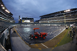 A Kubota tractor weighs down a tarp covering the playing surface at Lincoln Financial Field during the rain before the NFL game between the Chicago Bears and the Philadelphia Eagles on Sunday, December 22nd 2013 in Philadelphia. This image was taken with a fisheye lens. (Photo by Brian Garfinkel)