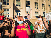 29 MAY 2020 - DES MOINES, IOWA: Black Lives Matter supporters at a vigil for George Floyd in front of the Des Moines Police station Friday evening. About 1,000 people attended the vigil. Floyd, a 46 year old unarmed African-American man, was killed by four Minneapolis police officers Monday evening May 25. The four police officers were fired from the Minneapolis Police Department. Officer Derek Chauvin, seen in videos with his knee on Floyd's neck, was charged with third-degree murder and second-degree manslaughter on Friday in Floyd's death. The death of George Floyd, while he was restrained and in police custody, has set off protests and vigils across the US.       PHOTO BY JACK KURTZ