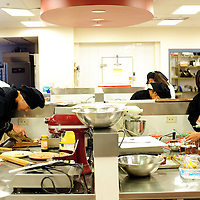 112712  Adron Gardner<br /> <br /> Area high school students get busy in a Miyamura High School kitchen for a University of New Mexico Gallup Center for Career and Technical Education class .