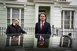 © London News Pictures. 27/03/2013 . London, UK.   Former British Foreign Secretary, David Miliband MP (right), leaving his London home to travel to his constituency in South Shields after he resigned as the MP for South Shields to take up a role for US based charity International Rescue Committee in New York. Photo credit : Ben Cawthra/LNP