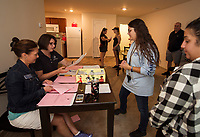 Marsha Bourdon and Julie Morin assist Geanina Swanay and her cousin Sarah Randall with student apartment  checkin at Apple Ridge during Move In day at Lakes Region Community College on Sunday.  (Karen Bobotas/for the Laconia Daily Sun)
