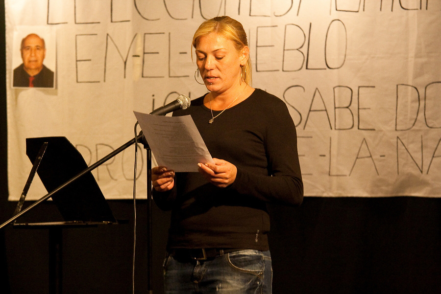 A woman from a regional prison reads a poem which she wrote in the framework of Woman's day.
