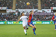 Kyle Naughton of Swansea City and Martin Kelly of Crystal Palace during the Premier League match between Swansea City and Crystal Palace at the Liberty Stadium, Swansea, Wales on 26 November 2016. Photo by Andrew Lewis.