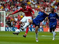 Photo: Ed Godden.<br />Nottingham Forest v Bradford City. Coca Cola League 1.<br />05/08/2006. James Perch (L) is tackled by Bradford's David Graham.