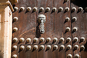 Old metal door-knocker of historic house   in the old city of Ronda, Spain