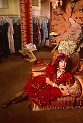 A formal portrait of English fashion designer, Zandra Rhodes in the summer of 1989 at her Grafton Street boutique, central London England. Dame Zandra Lindsey Rhodes, DBE RDI b1940 studied first at Medway and then at the Royal College of Art in London. Her major area of study was printed textile design.