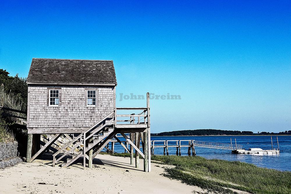 Rustic boathouse on the beach, Chatham, Cape Cod, Massachusetts, USA