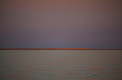 The first rays of sunlight catch the sandspit at Adele Island.