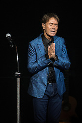 © Licensed to London News Pictures . 04/10/2015 . Manchester , UK . SIR CLIFF RICHARD steps on stage to a standing ovation and performs at the Bridgewater Hall in Manchester . Photo credit: Joel Goodman/LNP