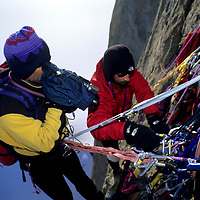 ANTARCTICA. Mike Graber films Jon Krakauer high on Great Sail Peak.