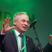 Richard Bruton TD, Minister for Education and Skills ,Irish Government addresses the crowds at the London's St Patrick's Parade  on 19th March 2017. by See Li